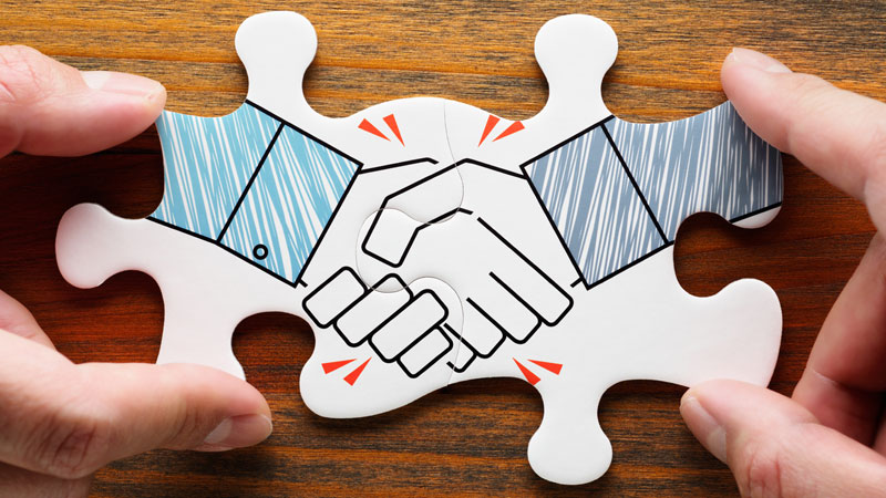 a handshake signifying trust between a client and an agency